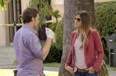 "Michael C. Hall and Jennifer Carpenter in ""Dexter."""